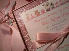Baby Girl announcement. Comes with beautiful sparkle pink backing paper, satin bow, 3D sheep embellishment, pink box with grossgrain ribbon AND a Pandora Style charm. Each box could have a different charm and the guests bring them to the mother to be part of her bracelet. When the box opens, Rock a Bye Baby plays. It is the sweetest thing you ever saw/heard!