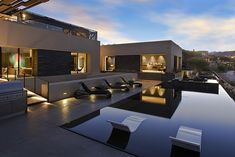 View of the Tresarca home in Las Vegas after sunset. Gorgeous pool!