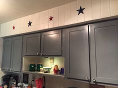 Finally finished the kitchen. Iron stars from Texas painted patriotically & one more mounted light to showcase my little shelf.