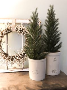 room decor Transition your Christmas decor to winter decor by using evergreen trees in croc. Transition your Christmas decor to winter decor by using evergreen trees in crocks for the winter. A Winter Mantel & Living Room Decor – Valley + Birch Christmas Living Rooms, Christmas Room, Cozy Christmas, Apartment Christmas, Winter Diy, Winter Home Decor, Holiday Decor, Winter Poster, Minimalist Christmas