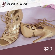 Charlotte russe size 7 sandals Size 7. All man made materials. Zip in back. Tan color. Never worn charlotte russe heels. Tie up in front. Open toe Charlotte Russe Shoes Heels
