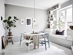 Modern way of creating a built in storage and seating solution and book shelf in one. I like it!