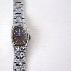 Vintage silver colored woman wrist watch 'Luch' ('Ray') with blue oval dial, soviet vintage, 1970s