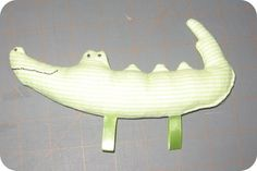 Taggy toy for baby - perfect shower gift inspired my rattle toys, squeaky toys and crinkle toys http://hmhdesigns.wordpress.com/2011/09/15/making-rattle-toys/