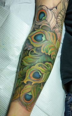 Peacock Sleeve Tattoo Looking for cover-up ideas for my left fore-arm. I like the idea of feathers, but a peacock I am not.