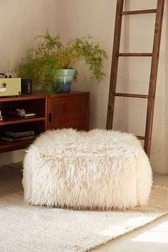 13 Stylish Poufs That Will Completely Transform Your E