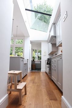 From Design Sponge, beautiful kitchen skylight (sky ceiling? Interior Exterior, Kitchen Interior, New Kitchen, Interior Design, Interior Modern, Kitchen Ideas, Narrow Kitchen, Kitchen Reno, Kitchen White