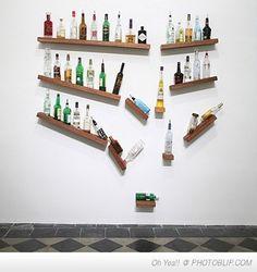 A still-motion shelf. Would be cool behind bar in basement.