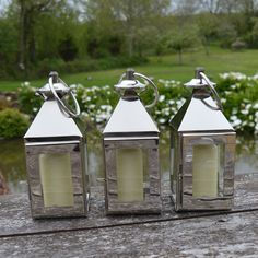 These silver lanterns are such cute accessories for the garden table. You can also hang them off hooks and branches! Silver Lanterns, Wedding Lanterns, Metal Lanterns, Candle Lanterns, Pillar Candles, Wedding Decorations, Colorful Pillows, Garden Table, Fake Flowers