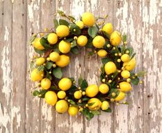 Summer Wreaths: Gorgeous Fruit Arrangements Wreaths. Bring summer to your front door with this easy tutorial using summer-inspired fruit and greenery. #summer #wreaths #DIY