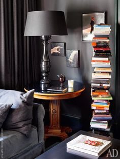 Love the artwork and the book tower in this vignette.