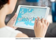 KIEV, UKRAINE - MAY 21, 2014: Woman looking on Google Maps application on a brand new white Apple iPad Air. Google Maps is a most popular web mapping service for mobile provided by Google inc.
