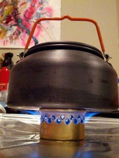 Turn a cat food can into a stove.