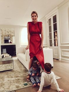 First daughter Ivanka Trump took to social media to share sweet images of her three young children playing a game of peak-a-boo while trying to hide under her red, floor-length gown Tuesday. Ivanka Marie Trump, Ivanka Trump Style, Ivanka Trump Dress, Ivanka Dress, Trump Kids, Trump Children, Young Children, Washington Dc Fashion, Ivana Trump