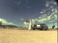 wedding dress photos in front of ruins with fireworks on route 66