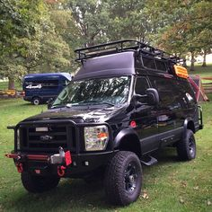 Ford van with Aluminess front and rear bumper and roof rack