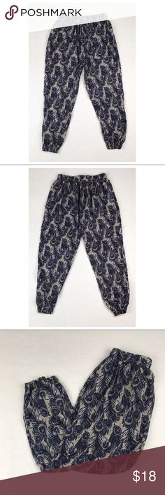 """Anthropologie Staring At Stars Peacock Print Pant Pre owned in good condition (as the pics show). No stains, snags, or holes.                                                ▪️Measurements (while laid flat):  Total Length= 36.75"""" Inseam= 23"""" Waist= 13.75"""" Thigh= 12.5"""" Rise= 14.75"""" Bottom Leg opening= 4""""                                                                                  ▪️Open to reasonable offers 😃 Anthropologie Pants"""
