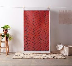 Photographic image of red bricks transformed in a trendy bright red chevron pattern fabric by khoncepts.com