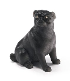 the attentive figure of the pug carved of silver sheen obsidian, set with diamond eyes, probably Fabergé height 1 1/4 in., 3.1 cm