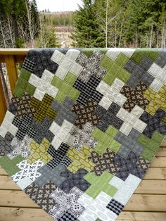 "Made for my 16 year old son.  Still needs binding, but wanted to catch a picture this nice day!  Fabric: Curious Nature by Parson Gray Size: 67"" by 90""  Blogged at coraquilts.blogspot.ca/2012/06/curious-nature-for-boys.html"