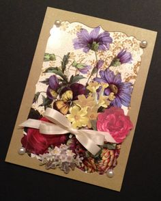 The heavily saturated background paper on this card is actually acetate from a collection of acetate floral-patterned papers by Anna Griffin. I regret that I do not recall the name of the collection; it was offered on HSN several years ago.