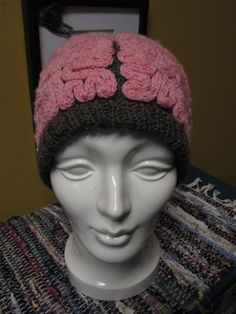 Hand-knitted warm wool brain hat! The base of the hat is knitted from charcoal heather recycled wool yarn, the brainy part (gyri and sulci) are pink