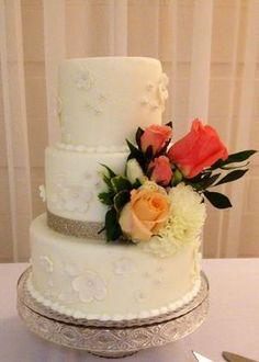 Wedding Cake with playful flowers as well a real flower bouquet by Frost Dessert Shoppe in Baden ON