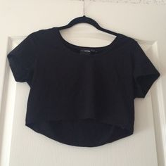 NWOT Asos petite black crop top. Petite black crop top. Stretchy material. The quality of this is super nice, it will last you forever!! Never worn, brand new without tags. Purchased in the wrong size otherwise I would totally keep! ASOS Tops Crop Tops