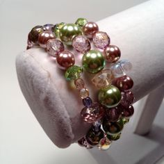 glass bead bracelet set w/ mint green and taupe pearls, purple, blue, clear, green, and pink czech beads, mint green crystals and luster by PerfectlyTangledCo on Etsy https://www.etsy.com/listing/172071824/glass-bead-bracelet-set-w-mint-green-and
