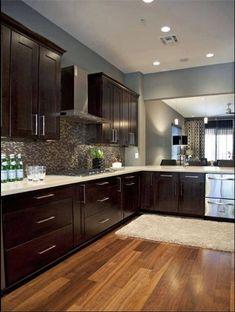 Dark cabinets. Light counters (Tile Floor, avoid Wooden Flooring in Kitchens)