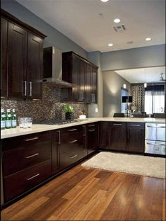 Dark cabinets. Light counters (Tile Floor, avoid Wooden Flooring in Kitchens)