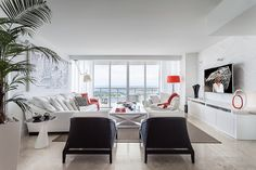 Elegant Spacious Living Room With White Sofa And Black Armchairs Plus ...