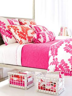 Bright floral print, great for a teenage girl's room! My mom would actually love this since it's pink and orange :)