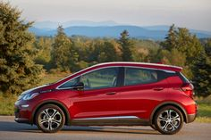 2020 Chevy Bolt EV is an all-electric hatchback with a long driving range, spacious cabin, and affordable price tag. The Bolt EV has a range of 259 miles and . Electric Car Reviews, Electric Cars, Car Cost, Nissan Leaf, Car Salesman, Automobile Industry, Creature Comforts, Car Shop, Used Cars