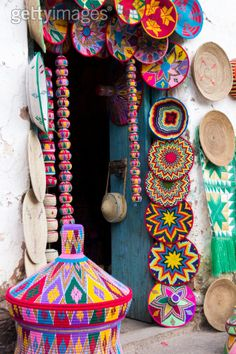 Africa | Baskets on display at the entrance of a souvenir shop.  Axum, Ethiopia | ©Tim Bewer / Lonely Planet Images