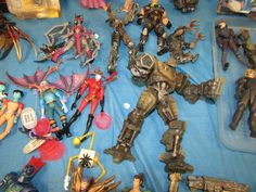 Toys, comic books, magazines. Toys include action figures and accessories and dolls. Comic books and magazines include Sin City, Batgirl, epic, Heavy Metal, various military booklets, etc.