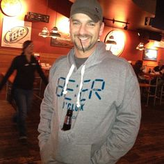 Country Music Star Craig Campbell rocking the Team Cocktail Beer Pouch Sweatshirt!