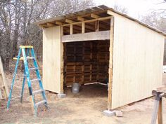 DIY Pallet Shed-I'd love to make one of these to store my garden tools in.