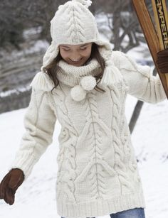 Big Aran Sweater and Earflap Hat - Free pattern   Yarnspirations - Chunky long white sweater with fun collar and Aran-inspired cables. Matching hat w/ earflaps.