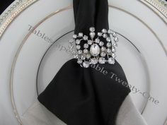 SILVER CHARGER WITH PINK AND BLACK PLACESETTING   found these fabulous crown napkin rings at…you guessed it!… Z ...