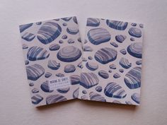Lovely little notebook with illustrated cover with shinlges pattern.