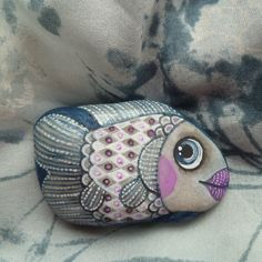 Whimsical fish Pebble is painted watercolors and tempera paints