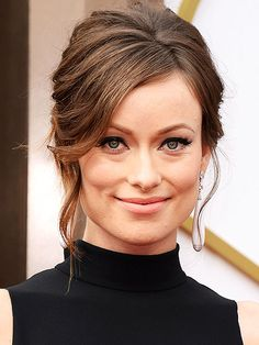 Olivia Wilde (Oscars 2014) - elegant updo with lots of height at the crown an oversize bun in the back