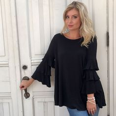 """There's no such thing as having too much black in your closet """"Sure Thing"""" ruffle top ($46) FAST & FREE SHIPPING from Ohio Sanitystyle.com 440.893.9279 sales@sanitystyle.com to order or shop in store #sanitystyle #sanitychagrinfalls #shoplocal #chagrinfalls #shopchagrinfalls #boutique #freeshipping #cleveland #clevelandfashion #clevelandstyle #style #shop #cle #thisiscle #love #selloninsta #instasale #fashionpost #beautiful #picoftheday #shopping #shopaholic #retailtherapy #instaboutique…"""