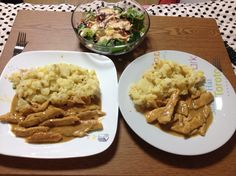 Chicken in cream sauce and roasted potatoes.