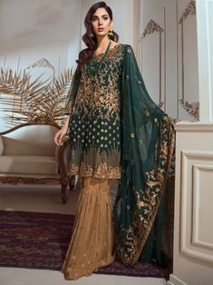 Breathtaking green partywear straight cut suit online which is crafted from georgette fabric with exclusive embroidery work. This stunning designer straight cut suit comes with santoon bottom and chiffon with heavy work dupatta. Salwar Dress, Pakistani Salwar Kameez, Pakistani Suits, Sharara Suit, Sabyasachi, Salwar Suits, Pakistani Fashion Party Wear, Pakistani Bridal Wear, Party Fashion