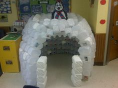 """My Pre-K class collected and washed 250 milk gallons.  While exploring a winter unit about reducing, reusing and recycling, we """"reused"""" milk gallons to create a classroom igloo!"""