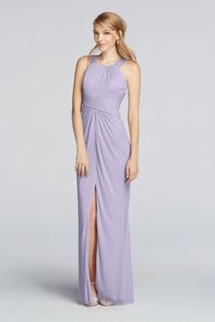 Set the scene with this light weight mesh bridesmaiddress.   A high neck, beaded halter, and front slit combine to create a polishedlook.  Mesh fabric and a ruched waist will compliment your body shape.  Fully lined. Zipper Back. Imported polyester. Dry clean only.  Available in Extra Length sizes as Style 4XLF17093. To protect your dress, try our Non Woven Garment Bag.
