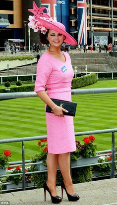 Stylish: Racegoer Jennifer Wrynne accessorised her all-pink look with a black YSL clutch