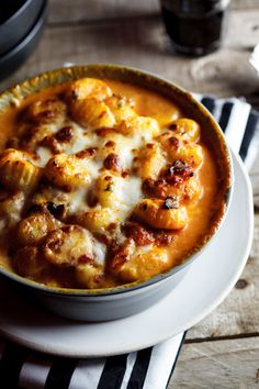 Baked gnocchi with bacon, tomatoes and mozzarella
